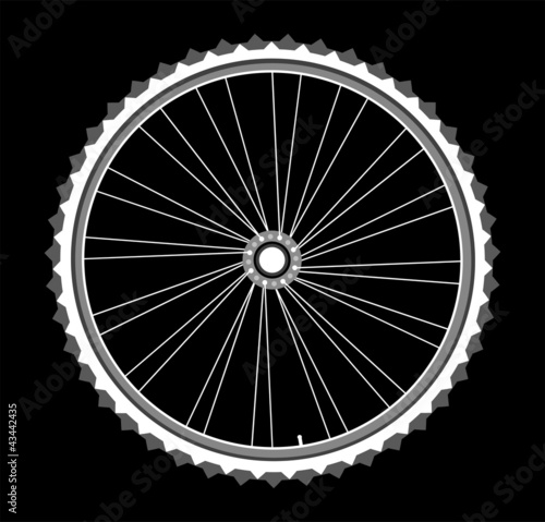 white bicycle wheels on black background