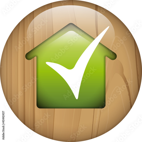 wooden button with green house and ok