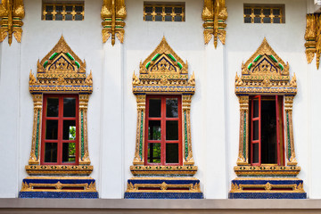 Golden windows of Temple in Bangkok Thailand.