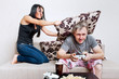 Young Couple Siting On Sofa At Home