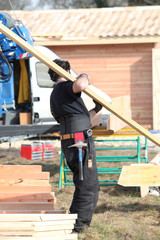 carpenter holding planks