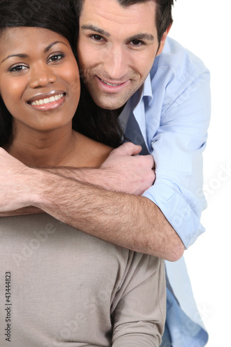 Couple embracing on white background