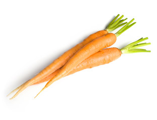 Fresh carrot in front of white background
