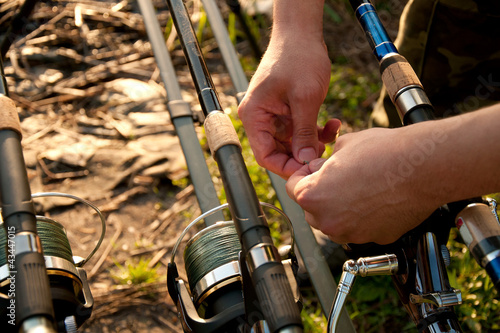 Fisherman hands with equipment