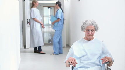 Patient  with a wheelchair in a hallway