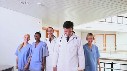 Doctors with nurses walking