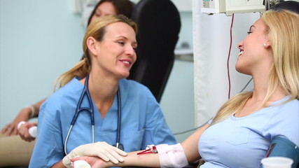 Nurse checking the monitor of a patient