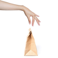 hand picking paper bag.