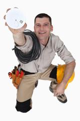 Laborer showing smoke detector