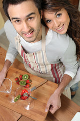 Couple making fruit cocktails