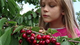 Girl and a cherry