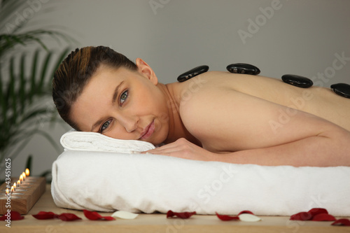 young woman relaxing in a spa center