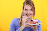 Woman eating a strawberry cake
