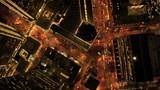 Aerial vertical view at night of city traffic illuminated, USA