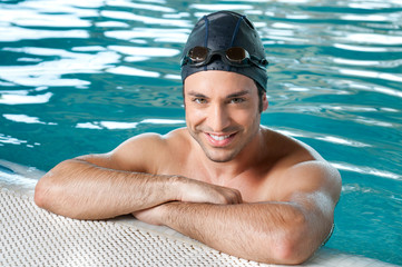 Happy man swimming