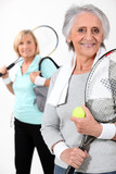 Two elderly women playing tennis