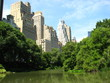 Skyscrapers of Manhattan from Central Park with Lake and Trees i