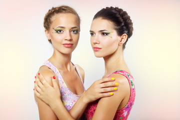 Two girls with colored make-up