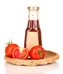 Tomato sauce in bottle on wicker mat isolated on white