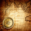 old compass and rope on vintage map 1732