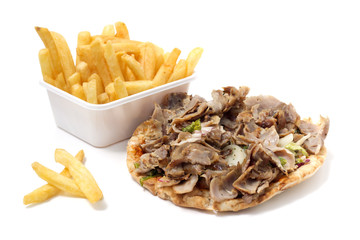 Roasted meat on tortilla with french fries