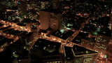 Aerial night illuminated view of city streets, America