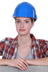 Portrait of woman with construction helmet