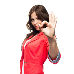 Young business woman doing Ok gesture. Focus on hand