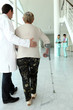 Medical assisting elderly woman in walking