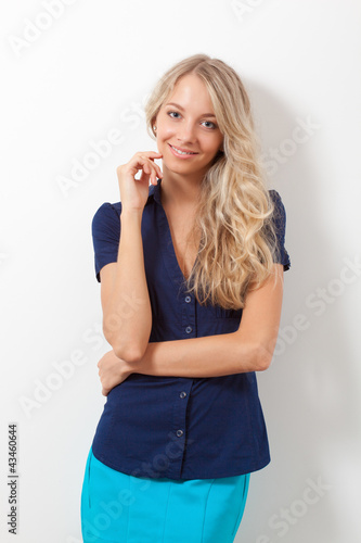 blonde woman over white wall