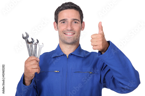 plumber holding wrenches all smiles