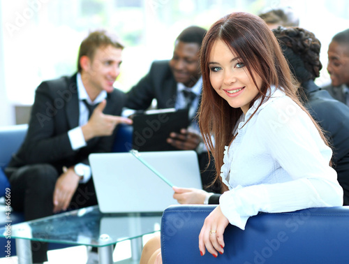Closeup of a pretty young businesswoman smiling