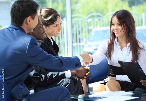 Happy smiling businesswoman shaking hands after