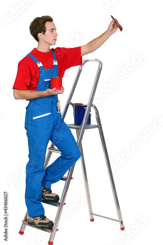 Painter on a ladder.