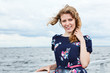 Woman enjoying life on the deck of cruise yacht on wind and look