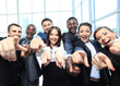 Portrait of excited young business people pointing