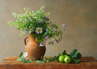 Still life with wildflowers and green apples