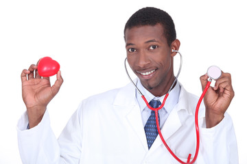 Doctor holding a stethoscope and a plastic heart