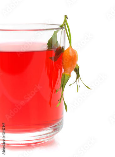 cup of tea from the berries of wild rose on a white background