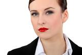 Businesswoman wearing red lipstick