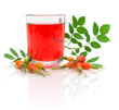 cup of tea with rose hips and berries ripe rose hips on a white