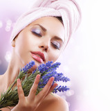 Fototapety Spa Girl with Lavender Flowers. Beautiful Young Woman After Bath