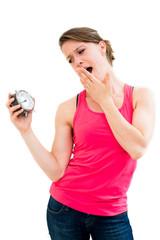 Wait,young beautiful woman holding a clock