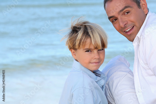 father and his son near the sea