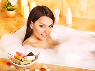 Young woman take bath.