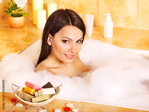 Young woman take bath.
