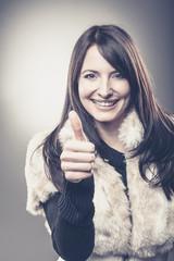 Frau mit motivierender Pose