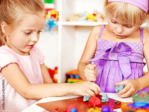 Child playing plasticine.