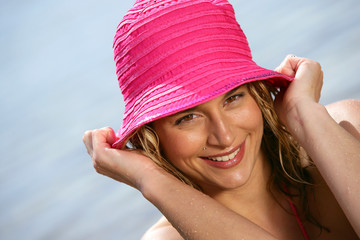 Woman wearing a pink hat