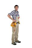 Casual male carpenter  stood with hands on hips
